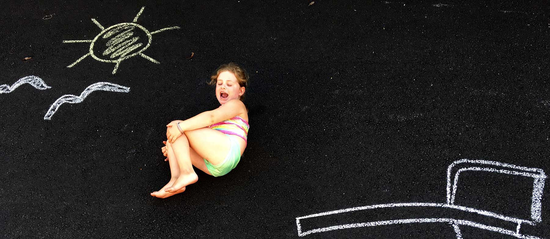 Camper with Chalk Drawings | Caravel Day Camp